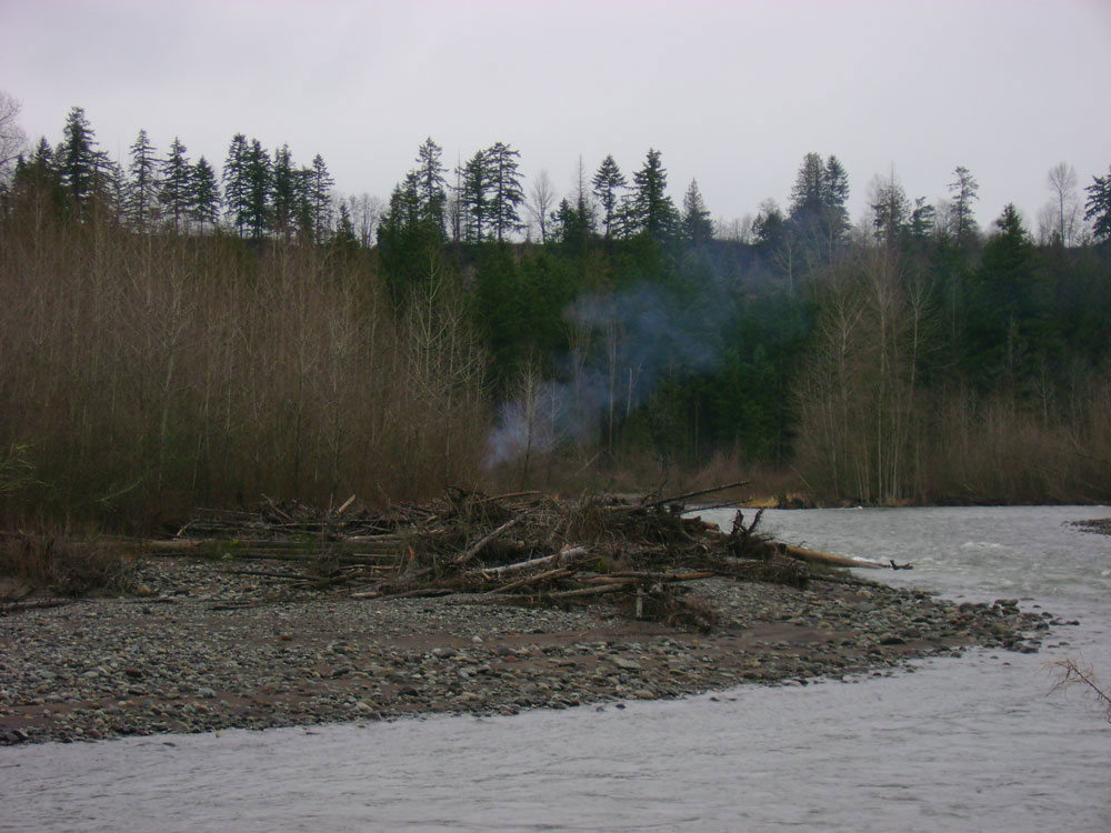 Hunters' campfire across the river
